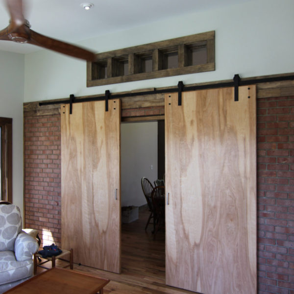 Sunroom with large sliding wooden barn doors