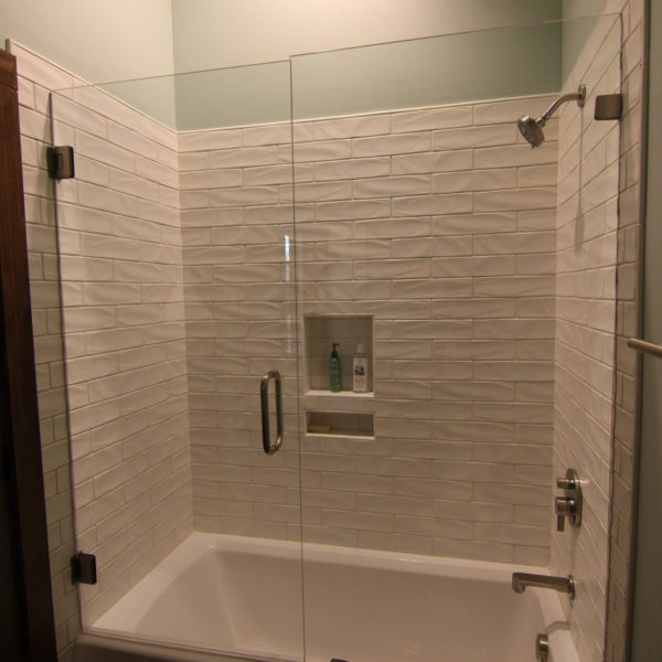 Modern guest bathroom with large bathtub/shower combination