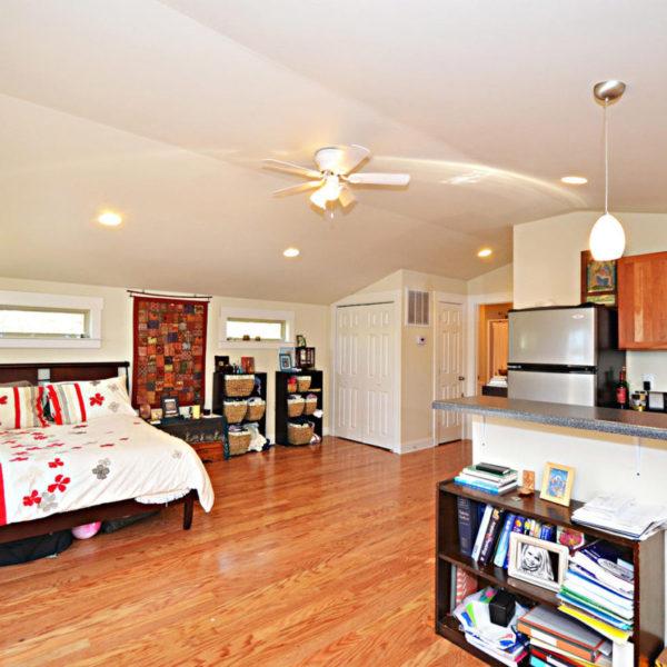 Garage apartment with kitchenette and bedroom open floorplan