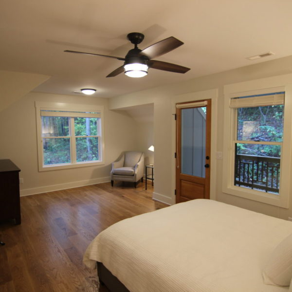 Upper modern bedroom with clean aesthetic and wood floors