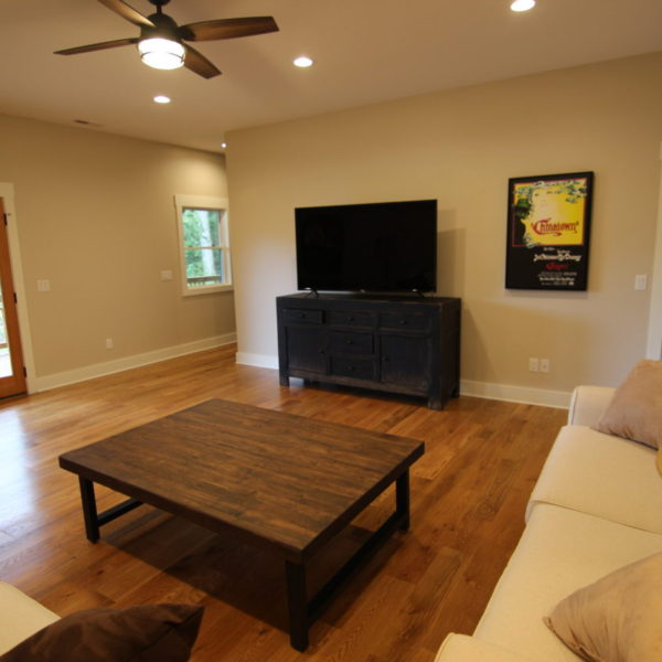 Lower living room area with hardwood floors