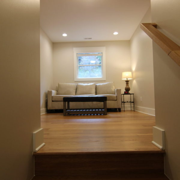 Upper reading nook with wood floors