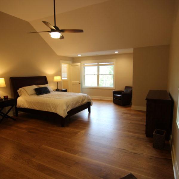 Upper modern bedroom with hardwood floors
