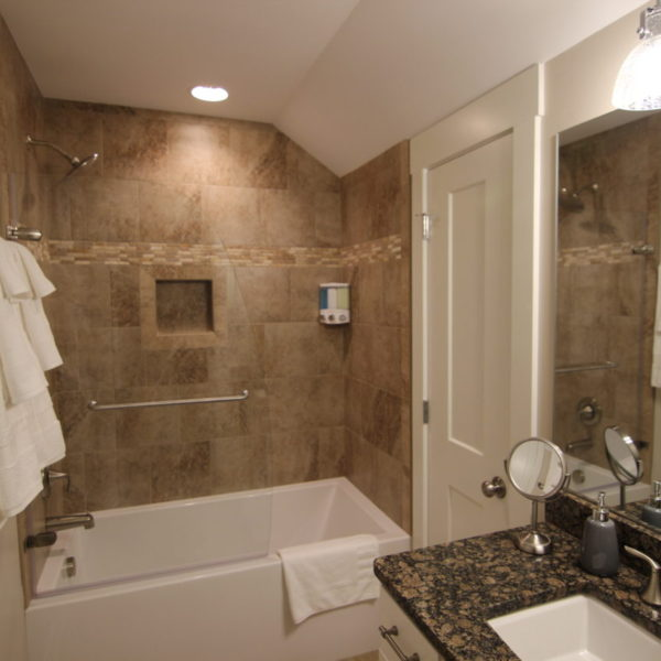 Lower bathroom with modern features and large bathtub/shower combination