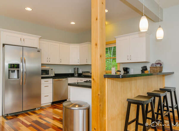 Modern kitchen with multicolored wood floors