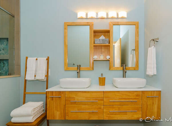 Contemporary modern master bathroom with large double sinks and wooden features