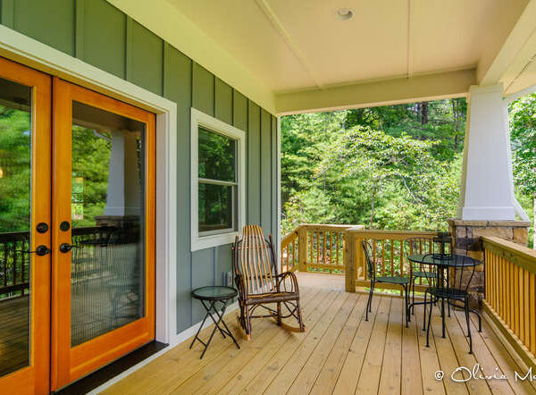 Rear wooden porch with sitting area