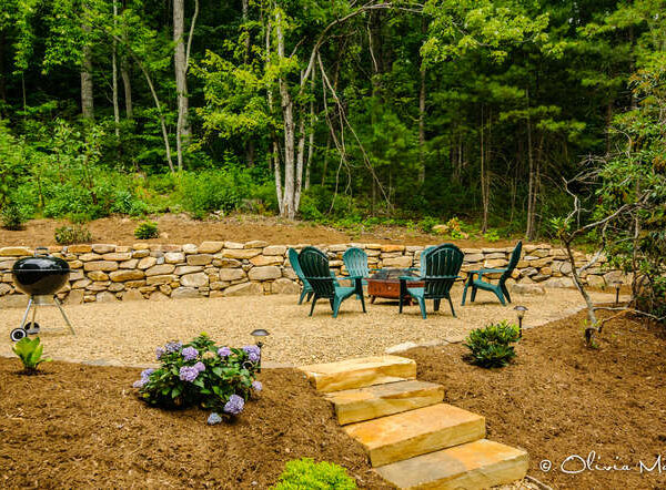 Outdoor patio with firepit and lawn chairs