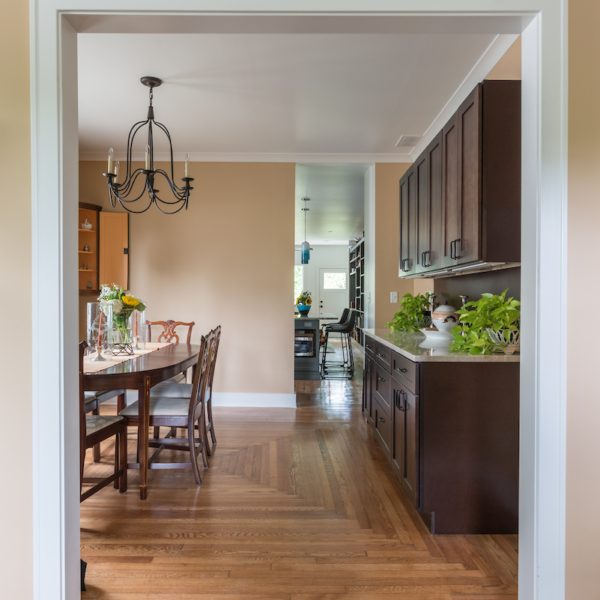 Traditional dining room view with wooden cabinets