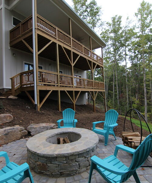 Backyard patio with stone above-ground fire pit