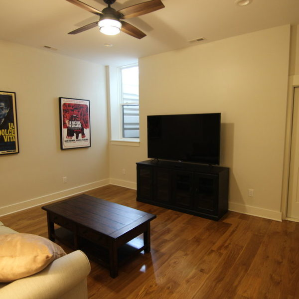Media room with wood floors