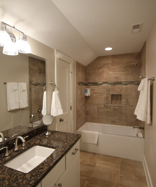 Modern second bathroom design with tile floors and tiled shower