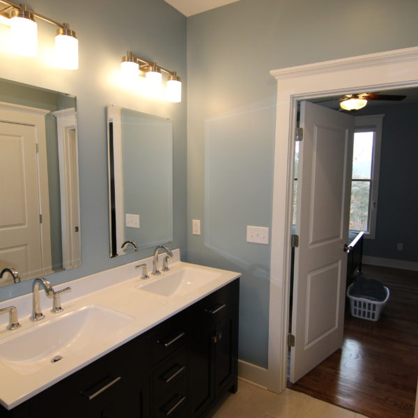 Modern bathroom design with light blue walls and double sinks