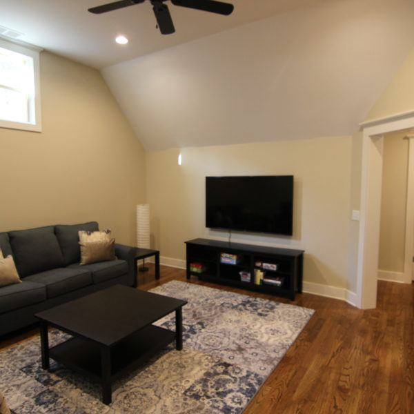 Classic media room with sofas and wood flooring