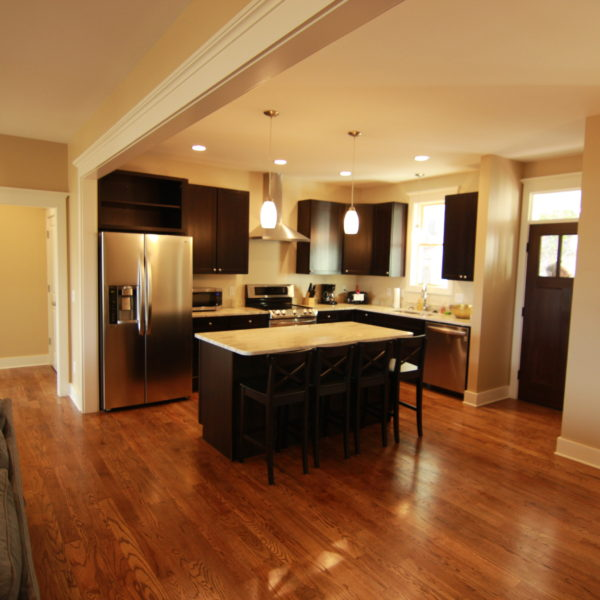 Open kitchen and living room with wood floors