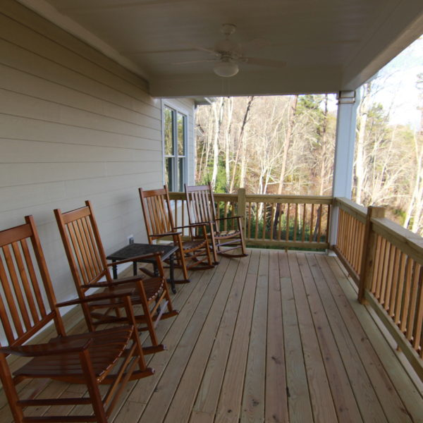 Front wooden deck with rocking chairs and mountain views