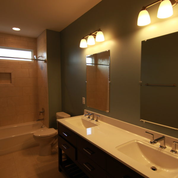 Traditional bathroom design with double sinks