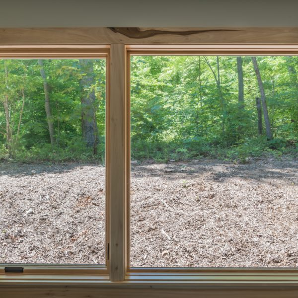 Wooden picture window in bedroom