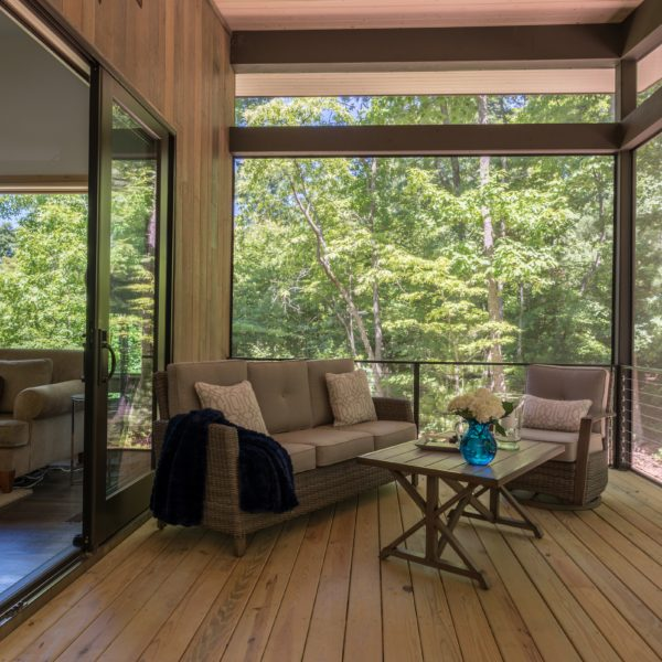 Enclosed living room wooden porch area