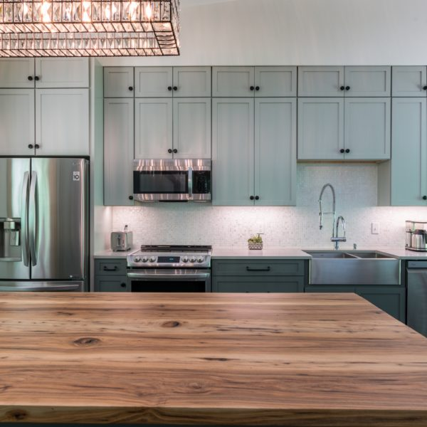 Contemporary kitchen design with custom light blue cabinets