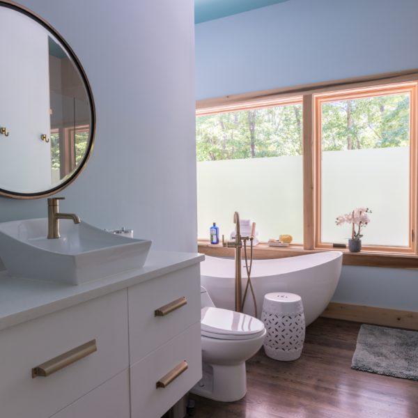 Contemporary master bathroom with white accents and unique bathtub