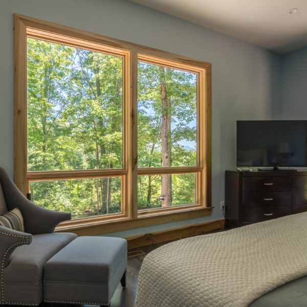 Modern master bedroom design with picture window