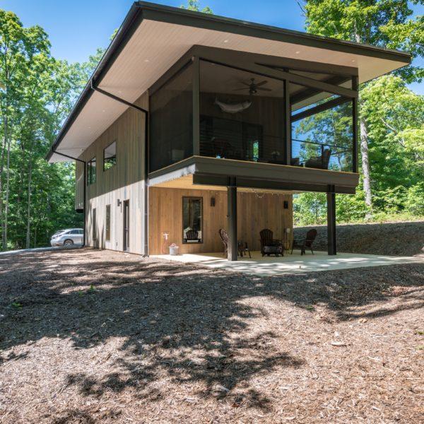 Exterior of modern contemporary home with bottom floor patio
