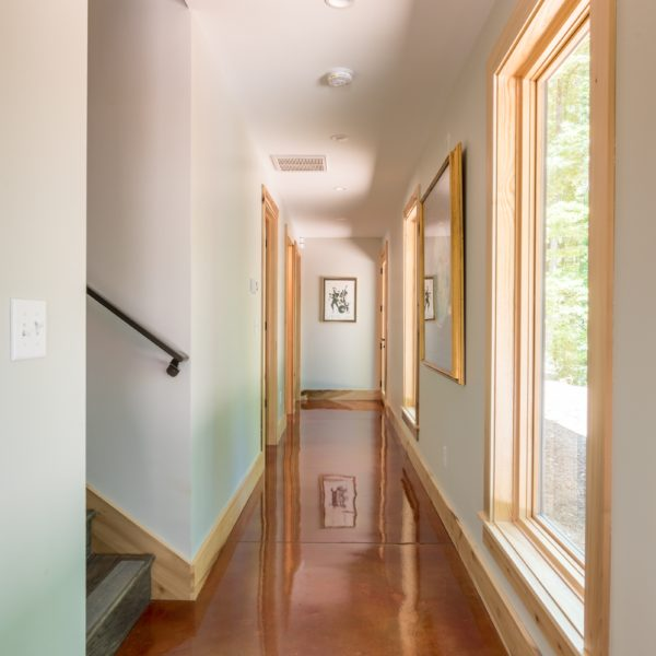 Hallway with wooden accents and glassy floor