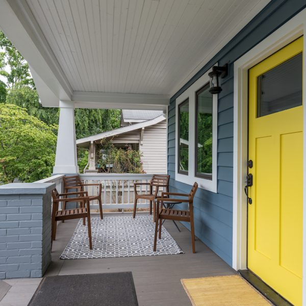 Front porch with yellow door accent